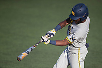 Michigan Wolverines outfielder Christian Bullock (5) swings the bat during the NCAA baseball tournament against the Connecticut Huskies on June 4, 2021 at Frank Eck Stadium in Notre Dame, Indiana. The Huskies defeated the Wolverines 6-1. (Andrew Woolley/Four Seam Images)