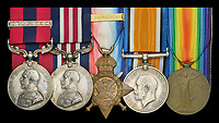 BNPS.co.uk (01202 558833)<br /> Pic: DixNoonanWebb/BNPS<br /> <br /> Pictured: William Tapsell's medals.<br /> <br /> The heroism of a Tommy who rescued 19 comrades buried in dugout after a shell attack can be revealed after his medals sold for £10,000.<br /> <br /> Second Lieutenant William Tapsell, of the 2nd Battalion, Lincolnshire Regiment, went to their aid after a German gas shell attack on the Western Front in the summer of 1917.<br /> <br /> He started digging out men wearing a gas helmet but because of the darkness was struggling to see so he took it off.<br /> <br /> By doing so he risked his own life as six of the men trapped were killed by lethal fumes.