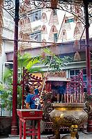 Sin Sze Si Ya Taoist Temple, Chinatown, Kuala Lumpur, Malaysia.  Temple Worker Hanging Incense Coils. Oldest Taoist temple in Kuala Lumpur (1864).