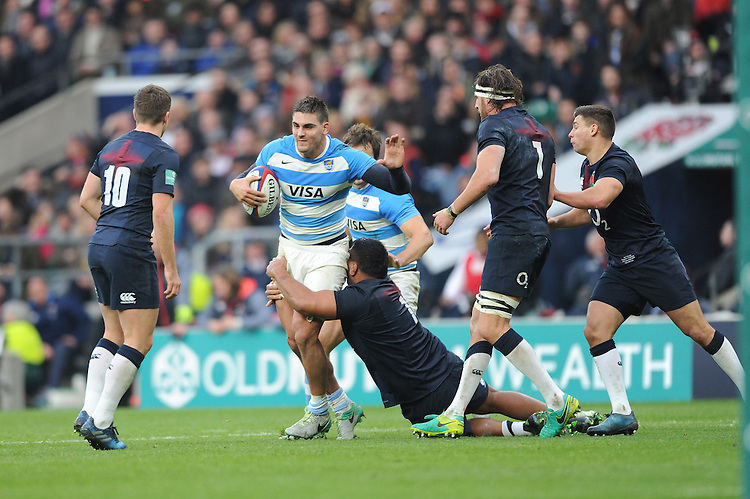 Pablo Matera of Argentina is tackled by Mako Vunipola of England during the Old Mutual Wealth Series match between England and Argentina at Twickenham Stadium on Saturday 26th November 2016 (Photo by Rob Munro)