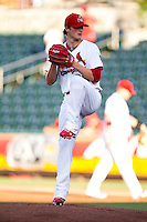 Shelby Miller (26) of the Springfield Cardinals winds up during a game against the Tulsa Drillers at Hammons Field on July 20, 2011 in Springfield, Missouri. Springfield defeated Tulsa 12-1. (David Welker / Four Seam Images)
