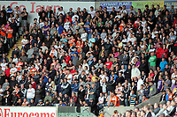 Pictured: Swansea City fans in action. Saturday 17 September 2011<br /> Re: Premiership football Swansea City FC v West Bromwich Albion at the Liberty Stadium, south Wales.