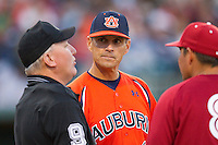 Auburn Tigers head coach John Pawlowski #8 goes over the ground rules with home plate umpire Tony Walsh prior to the game against the Alabama Crimson Tide at Riverwalk Park on March 15, 2011 in Montgomery, Alabama.  Photo by Brian Westerholt / Four Seam Images