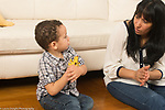 Mother in her mid-40s talking to 2 year old toddler son who is talking back
