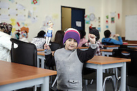 Pictured: A young child in the class Monday 06 February 2017<br /> Re: A school teaching the English language has been operating at the migrant camp located in the former airport in the outskirts of Athens, Greece.