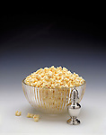 bowl of popcorn with salt shaker