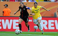 Christie Rampone (l) of team USA and Daiane of team Brazil during the FIFA Women's World Cup at the FIFA Stadium in Dresden, Germany on July 10th, 2011.
