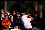 Tiger Woodstees off morning light at the Genuity Open at Doral in Miami, Fl.