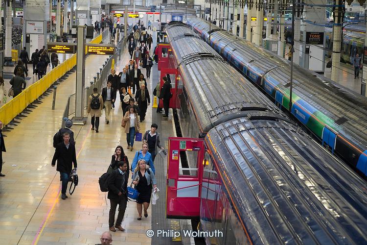 Passengers boarding a train at Paddington station London