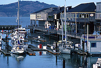 Boats docked at the pier in San Francisco Bay, San Francisco, California..