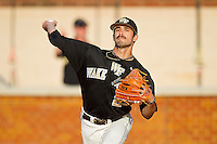Michael Dimock #23 of the Wake Forest Demon Deacons warms up in the bullpen during the game against the Miami Hurricanes at Gene Hooks Field on March 19, 2011 in Winston-Salem, North Carolina.  Photo by Brian Westerholt / Four Seam Images