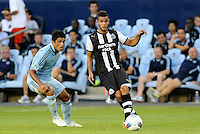 Newcastle United midfielder Hatem Ben Afra passing  away from Jeferson Sporting KC... Sporting Kansas City and Newcastle United played to a 0-0 tie in an international friendly at LIVESTRONG Sporting Park, Kansas City, Kansas.