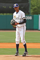 Kelvin Perez #22 of the Charleston RiverDogs pitching during a game against the Rome Braves on April 27, 2010 in Charleston, SC.