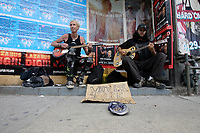 """Toronto (ON) CANADA,  April , 2008-<br /> <br /> Street Musicians playing (Social Distorsion's version of ) Johhny Cash """"Ring of Fire' on Queen street."""