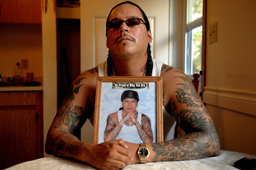 Richard Wolfe sits at his kitchen table in Fort Qu'Appelle, Sask. Wolfe and his late brother Daniel (in picture) founded the Indian Posse street gang. Daniel was murdered in a prison brawl in 2010. This was shot on assignment for The Globe and Mail in 2011 shortly after Richard completed a 15 year sentence for attempted murder. He told me all about it--how he chased a guy down a street and shot him over an unpaid debt. I also remember when I arrived at Richard's house a serviceman was installing a security system. Richard told me young gangsters could really make a name for themselves by killing him. Richard ended up going back to jail, where in his lifetime he spent a total of 640 days in solitary confinement. He died in the Prince Albert Penitentiary in 2016 at the age of 40.