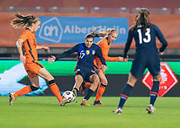 BREDA, NETHERLANDS - NOVEMBER 27: Tobin Heath #17 of the USWNT fights for the ball with Jackie Groenen #14 of the Netherlands during a game between Netherlands and USWNT at Rat Verlegh Stadion on November 27, 2020 in Breda, Netherlands.