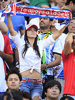 A Costa Rica fan holds a scarf