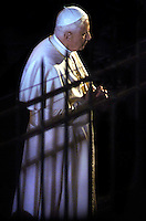 Pope Benedict XVI holds the wooden cross during the Via Crucis (Way of the Cross) torchlight procession on Good Friday in front of the Colosseum in Rome, Friday, April 6, 2007.The evening Via Crucis procession at the ancient Colosseum amphitheater is a Rome tradition that draws a large crowd of faithful, including many of the pilgrims who flock to the Italian capital for Holy Week ceremonies before Easter SundayVia Crucis;