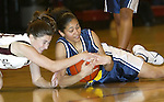 WATERBURY, CT,  02 JANUARY 2006, 010207BZ14- Kennedy's Jaleesa Roy (25) and Sacred Heart's Kelsey Dunn (14) fight for the loose ball during their game at Sacred Heart High School in Waterbury Tuesday.<br /> Jamison C. Bazinet Republican-American