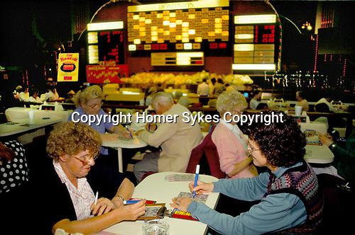 Bingo UK couple playing Bingo Club drinking beer north London. 1990s 90s