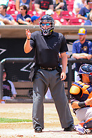 Home plate umpire Kyle Klink makes a strike call during a Midwest League game between the Wisconsin Timber Rattlers and the Quad Cities River Bandits on June 27, 2017 at Fox Cities Stadium in Appleton, Wisconsin.  Quad Cities defeated Wisconsin 6-5. (Brad Krause/Four Seam Images)