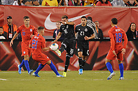 EAST RUTHERFORD, NJ - SEPTEMBER 7: Hector Herrera #16 of Mexico battles for the ball with Tyler Boyd #21 of the United States during a game between Mexico and USMNT at MetLife Stadium on September 6, 2019 in East Rutherford, New Jersey.