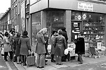 Fuel shortage 1970s UK. People queuing up to buy oil and paraffin from a corner shop The Oil Shop, so as to be able to heat their  homes south London. December 70s England.