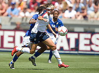 Carli Lloyd drives with the ball, .USA 1-0 over Brazil, Dick's Sporting Goods Park, Commerce City, Co, Sunday, July 13, 2008.