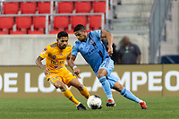 HARRISON, NJ - MARCH 11: Ismael Tajouri #29 of NYCFC is marked by Javier Aquino #20 of Tigres UANL during a game between Tigres UANL and NYCFC at Red Bull Arena on March 11, 2020 in Harrison, New Jersey.