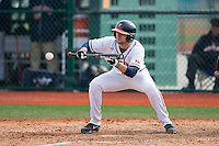 John La Prise (2) of the Virginia Cavaliers attempts a bunt against the Hartford Hawks at The Ripken Experience on February 27, 2015 in Myrtle Beach, South Carolina.  The Cavaliers defeated the Hawks 5-1.  (Brian Westerholt/Four Seam Images)