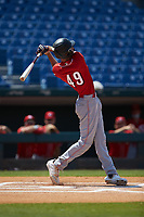 Benny Montgomery (49) of Red Land HS in Lewisberry, PA playing for the Cincinnati Reds scout team follows through on his swing during the East Coast Pro Showcase at the Hoover Met Complex on August 4, 2020 in Hoover, AL. (Brian Westerholt/Four Seam Images)