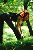 Red headed woman at play in park