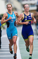 17 SEP 2011 - LA BAULE, FRA -  Svenja Bazlen (Triathlon Club Chateauroux 36) (left) and Jessica Harrison (Poissy Triathlon) run shoulder to shoulder at the front of the race during the final round of the women's French Grand Prix Series at the Triathlon Audencia in La Baule, France (PHOTO (C) NIGEL FARROW)