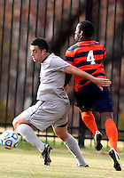 WASHINGTON, DC - NOVEMBER 25, 2012: Brandon Allen (10) of Georgetown University shields the ball from Jordan Murrell (4) of Syracuse University during an NCAA championship third round match at North Kehoe field, in Georgetown, Washington DC on November 25. Georgetown won 2-1 after overtime and penalty kicks.