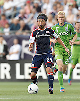 New England Revolution midfielder Lee Nguyen (24) short pass. In a Major League Soccer (MLS) match, the New England Revolution tied the Seattle Sounders FC, 2-2, at Gillette Stadium on June 30, 2012.