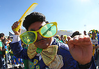 A Brazilian fan in fancy dress soaks up the atmosphere outside the Itaquerao stadium ahead of kick off in the opening match of the 2014 World Cup vs Croatia