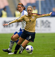 USWNT forward (5) Lindsay Tarpley moves past  Finland's (3) Jessica Julin during the Four Nations Tournament in  Guangzhou, China.  The US defeated Finland, 4-1.