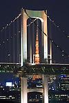 Japan, Tokyo, Odaiba, Tokyo Tower and Rainbow Bridge at Dusk