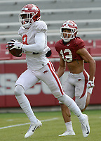 Arkansas receiver Mike Woods (left) makes a catch Saturday, April 3, 2021, ahead of defensive back Khari Johnson during a scrimmage at Razorback Stadium in Fayetteville. Visit nwaonline.com/210404Daily/ for today's photo gallery. <br /> (NWA Democrat-Gazette/Andy Shupe)