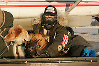Wednesday March 7, 2007    Veterinarian Justine Lee  brings dropped dogs to a waiting Pennair plane at the Nikolai checkpoint on Wednesday in 35 below temperatures