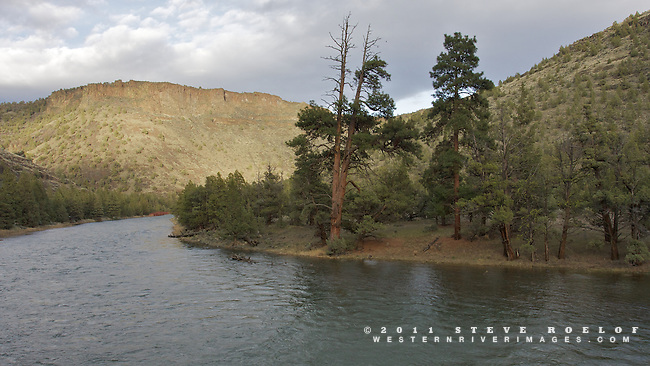The sun sets on rimrock and ponderosa along the Crooked River, Oregon.