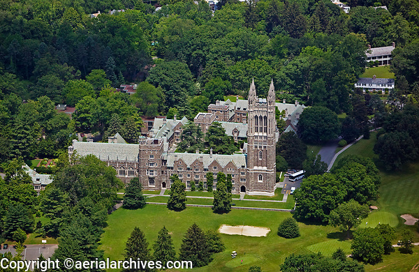 aerial photograph of the Princeton University Graduate College and Cleveland Tower, Princeton, New Jersey.  A portion of the Springdale Golf course is in the foreground.