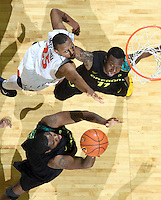 Dec. 17, 2010; Charlottesville, VA, USA; Oregon Ducks forward Joevan Catron (34) shoots the ball in front of Virginia Cavaliers forward Akil Mitchell (25) and Oregon Ducks guard Malcolm Armstead (11) during the game at the John Paul Jones Arena. Virginia won 63-48. Mandatory Credit: Andrew Shurtleff