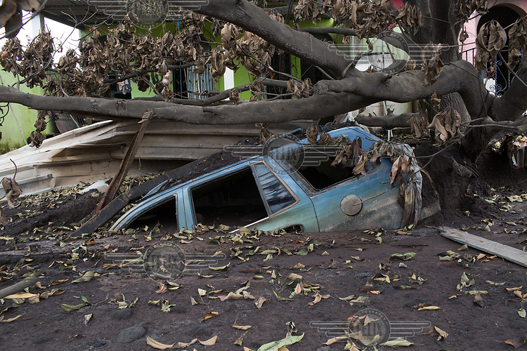 A partly buried car covered by volcanic debris in the community of San Miguel los Lotes following a violent eruption by the Fuego Volcano which completely destroyed the community on 3 June 2018. Over 110 victims have been identified, with at least 200 missing and thousands evacuated from neighbouring villages.