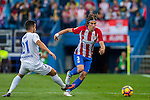 Filipe Luis (r) of Club Atletico de Madrid battles for the ball with Jonathan Rodriguez Menendez 'Jony' of Malaga CF during their La Liga match between Club Atletico de Madrid and Malaga CF at the Estadio Vicente Calderón on 29 October 2016 in Madrid, Spain. Photo by Diego Gonzalez Souto / Power Sport Images