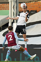 Joe Bryan of Fulham heads as Matty Cash of Aston Villa looks on during the Premier League match between Fulham and Aston Villa played behind closed doors due to current government covid-19 guidelines in Sport, played at Craven Cottage, London, England on 28 September 2020. Photo by Andy Rowland.