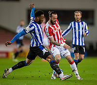 16th February 2021; Bet365 Stadium, Stoke, Staffordshire, England; English Football League Championship Football, Stoke City versus Sheffield Wednesday; Steven Fletcher of Stoke City is tackled by Chey Dunkley of Sheffield Wednesday