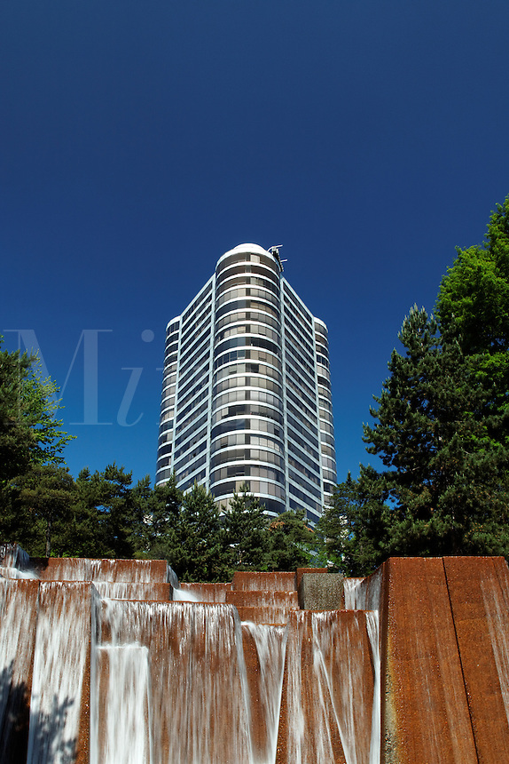 The Portland Plaza condominium towers above waterfalls in Keller Fountain Park, downtown Portland, Multnomah County, Oregaon, USA