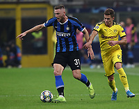 Football Soccer: UEFA Champions League -Group Stage- Group F Internazionale Milano vs Borussia Dortmund, Giuseppe Meazza stadium, October 23, 2019.<br /> Inter's Milan Skriniar (l) in action with Borussia Dortmund's Thorgan Hazard (r) during the Uefa Champions League football match between Internazionale Milano and Borussia Dortmund at Giuseppe Meazza (San Siro) stadium, on October 23, 2019.<br /> UPDATE IMAGES PRESS/Isabella Bonotto
