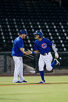 AZL Cubs center fielder Jose Gutierrez (91) is congratulated by third base coach Ben Carhart after hitting a lead-off home run in the first inning against the AZL Giants on September 6, 2017 at Sloan Park in Mesa, Arizona. AZL Giants defeated the AZL Cubs 6-5 to even up the Arizona League Championship Series at one game a piece. (Zachary Lucy/Four Seam Images)